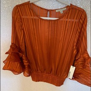 Ruffle puff sleeve cinched waist orange blouse